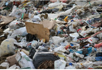 It's not hard to see wood, papers, cardboard and some other recyclables mixed in the garbage at the Iowa City Landfill