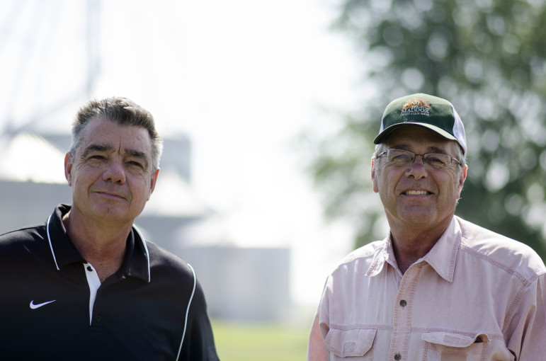 David (left) and Joe (right) Brown, brothers, pose for a photo on their family owned and operated centennial farm in Decatur,Ill., on June 19, 2013.
