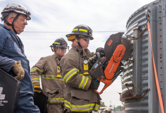 Firefighters learn how to cut grain-relief slots during grain-bin rescue training at the Danville Bunge facility on Tuesday, Sept. 17, 2013.