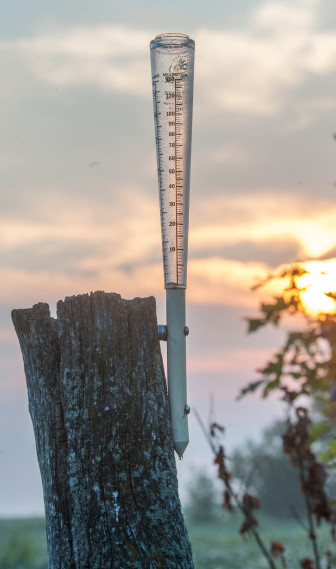 A rain gauge waits to measure rainfall near Mansfield, Ill., on Tuesday, Aug. 20, 2013. About a third of U.S. farmers and ranchers rely on irrigation methods in additional to any rainfall, according to 2008 Farm and Ranch Irrigation Survey data.