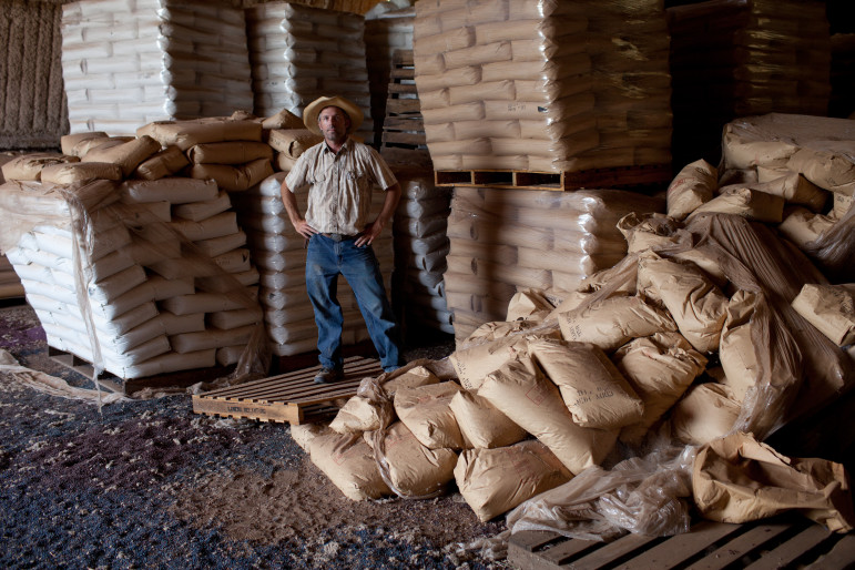 "Eric Herm, 40, unloads non-gmo cotton seed into a storage barn. Herm call this his ""Fort"