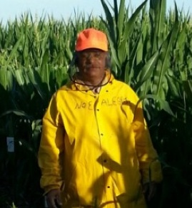Migrant worker Noé Alegria, in a Nebraska farm field in summer 2013. Alegria is one of 13 migrant workers who sued Monsanto in U.S. District Court in Texas for failing to pay wages due while working in Iowa. Monsanto settled the case.