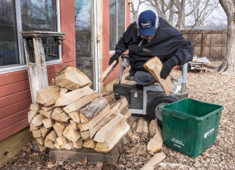 Chip Petrea moves wood in his backyard at home in Urbana, Ill., in January.