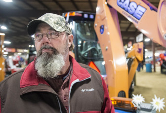 Leonard Johnson used to farm corn and soybean just west of Peoria. Here, he is pictured at the Midwest Ag Expo in Gifford, Ill., on Jan. 30, 2014.