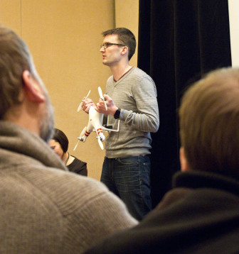 Matt Waite holds a drone while giving a presentation on citizen journalism in Baltimore. Waite is a professor of journalism at the University of Nebraska who teaches a class on the use of drones in journalism.
