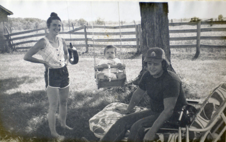 Chip Petrea is shown sitting outside near his wife, Susan, and their son, Tiras. Petrea met Susan during his senior year at the University of Illinois at Urbana-Champaign.