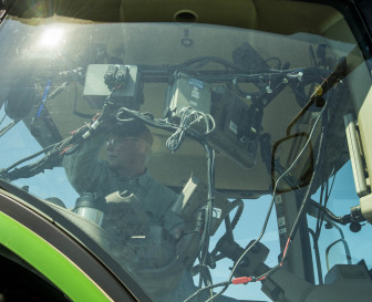 An Illinois farmer looks at electronics in the cab of his tractor on April 19, 2014.