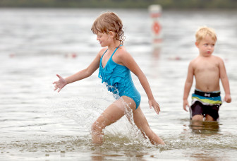 Tarah Delonay, 6, and her brother Ryan Delonay, 3, play at Madison's Vilas Park beach on Sept. 1, 2013. At Vilas, where geese have contaminated the water, beach closures dropped significantly in 2013.