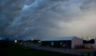 "A storm moves across the horizon in Savoy, Ill. ""It's really gotten to the point where the new normal is extreme weather,"" said Brad Rippey, a U.S. Department of Agriculture meteorologist."