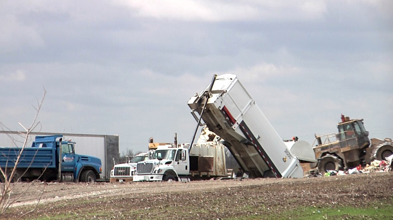 Trucks unloading garbage at the Cedar Rapids/Linn County Solid Waste Agency, where Marion, Iowa, takes its landfill waste. Photo taken May 2, 2014.