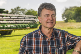 Mark Crawford stands at his farm near Danville, Ill. Crawford, who grows corn, soybeans and wheat on his large farm, said the crop insurance programs are important parts of the risk-management safety net for farmers.
