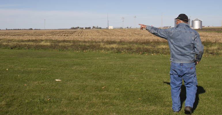 Lin Warfel walks across his central-Illinois corn and soybean farm on Nov. 5, 2014. Like many farmers, Warfel opposes the Waters of the U.S. rule.