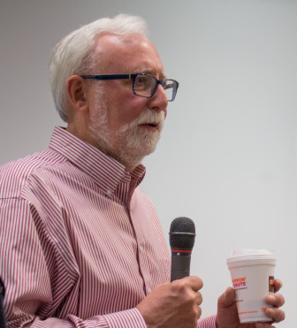 "Veteran investigative reporter Mike McGraw speaks to ""Covering the U.S. Visa System in Your Own Backyard"" fellows on April 11, 2015."