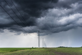 Extreme weather, such as this Midwestern summer storm, is one climate change consequence, according to experts. More weeds, insects and disease are others.