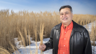 University of Illinois at Urbana-Champaign faculty member Jay Kesan at the UIUC biofuels research plot south of Urbana, Ill., on March 9, 2015.