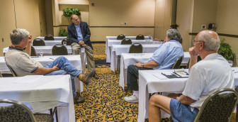 Former congressman and currenty lawyer Bill Enyart talks with farmers at the Hilton Garden Inn on Sept. 1, 2015. Enyart was advising farmers considering joining lawsuits against Syngenta.