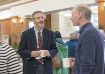 Conference presenter Mark David (left) talks with other attendees at the ISEE Congress 2015 in Urbana, Ill., on Sept. 15, 2015.