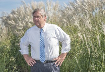 U.S. Secretary of Agriculture Tom Vilsack listens to a researcher on Sept. 10, 2015. He was at the UI Energy Farm just south of  Urbana, Illinois.