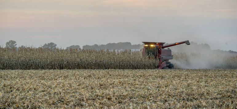 A central Illinois farmer harvests his crop as grain particles fly behind the tractor on Sept. 24, 2015. Besides the United States, Trans-Pacific Partnership countries include Japan, Mexico, Canada, Chile, Australia and six other countries.