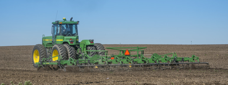 Tilling under a cell phone tower near Illiopollis, Ill., on April 14, 2016.