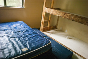 Inside a bedroom at the Pine Creek housing facility for migrant farmworkers in Holland, Michigan. Workers had to bring their own clothes, food and supplies. Rent a $35 per person per week.