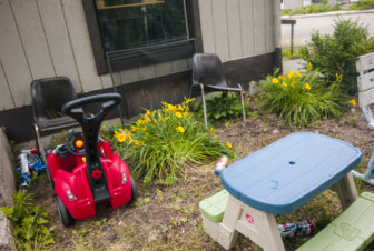 Toys are left outside the Pine Creek housing facility in Holland, Michigan. Farmworkers sometimes travel as families, meaning small children are exposed to the same housing dangers as adults.