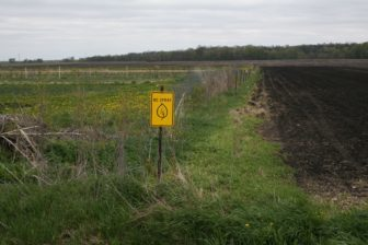A sign bordering Rob and Tammy Faux's property outside of Tripoli, Iowa.