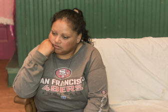 Maricruz Martinez Hernandez, 41, answers a reporter's questions at her seasonal home in New Haven, Missouri on June 25, 2016.