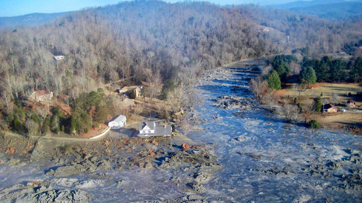 Coal ash spilling into a river