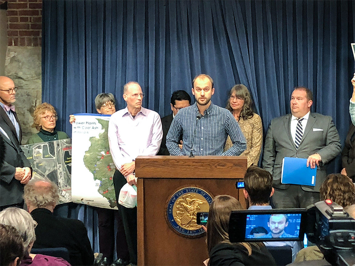 Andrew Rehn of the Prairie Rivers Network presents the report 'Cap and Run: Toxic Coal Ash Left Behind by Big Polluters Threatens Illinois Water' at a news conference at the Illinois state capitol building in Springfield