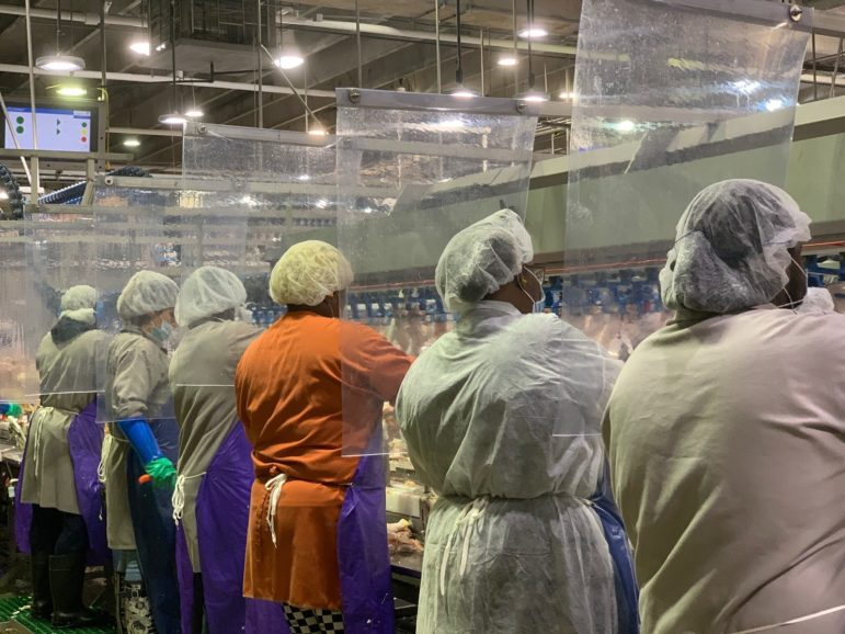 Tyson Foods installed plastic barriers between worker stations at its meat and poultry plants to protect against transmission of the coronavirus.