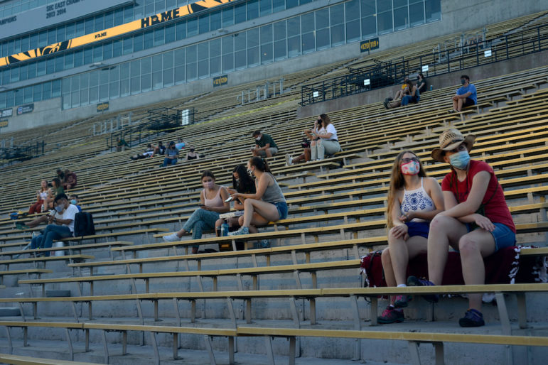"""Several groups of friends sit, socially distanced, while they wait for """"Star Wars: The Rise of Skywalker"""" to start on Saturday, Sept. 5, 2020 at Faurot Field in Columbia, Mo"""