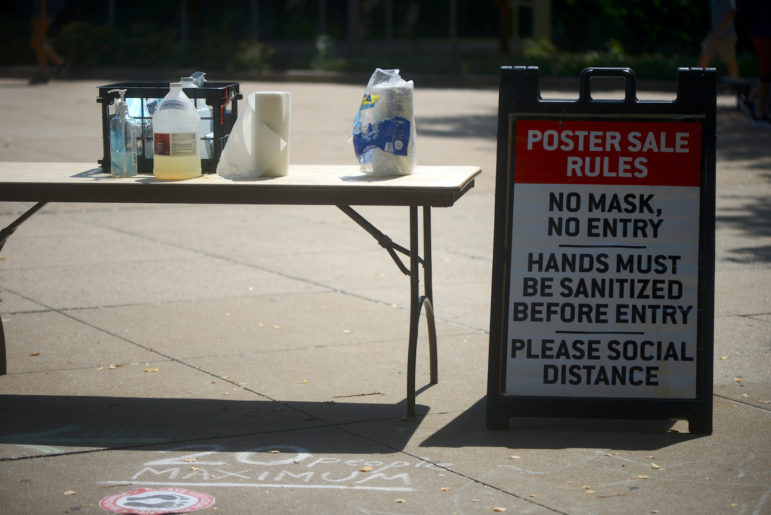 A sign on MU's campus in Columbia, Mo., photographed Aug. 24, 2020, outlines new rules for an annual sale outside the student center. Customers must wear a mask, social distance and sanitize their hands.