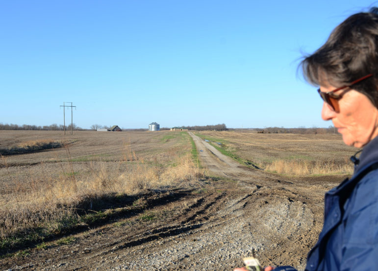Susan Fair stands in front of the permitted CAFO land.
