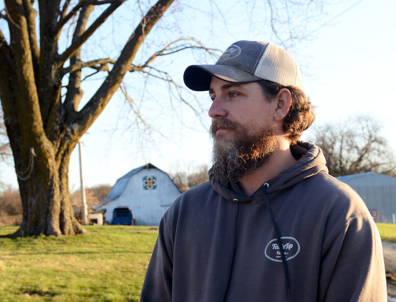 Andrew Geiser stands on his family's 100-year-old farm.